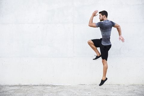 Athlete jumping in front of white wall