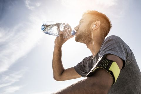 athlete resting and refreshing with water