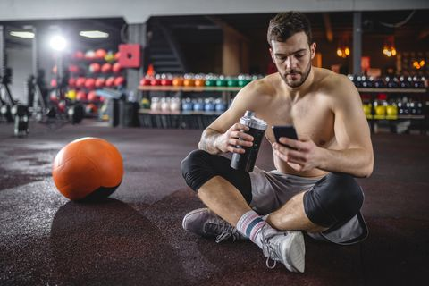 Athlete taking a breather to check his social media accounts