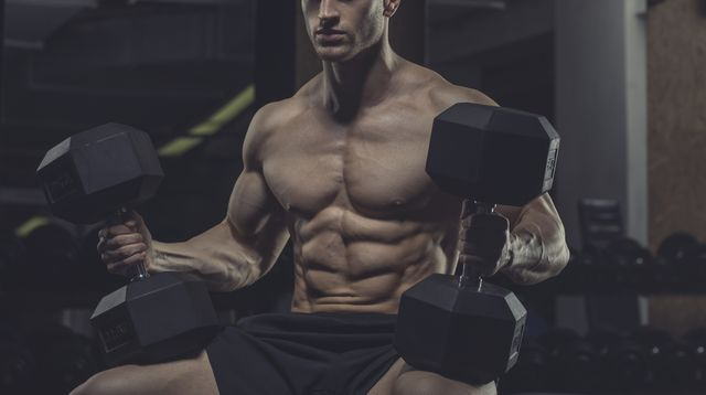 athlete with dumbbells