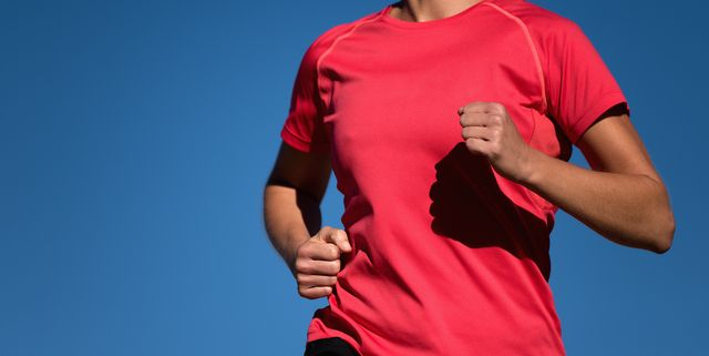 athlete woman running in red t shirt