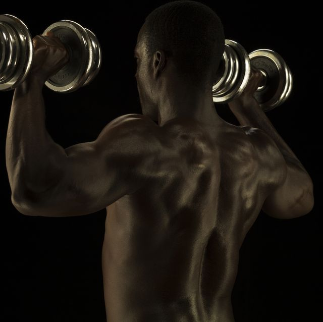 athletic male exercising with a hand weights