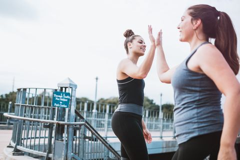 Athletic Women High Five After Run