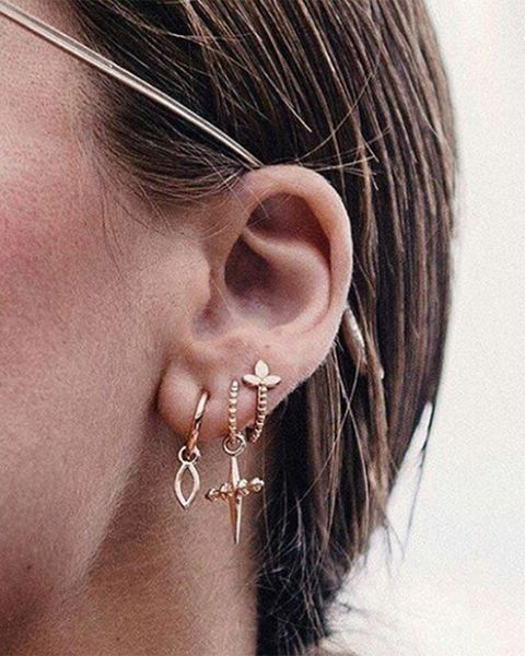 Ear, Hair, Face, Body jewelry, Earrings, Hairstyle, Organ, Body piercing, Fashion accessory, Jewellery,