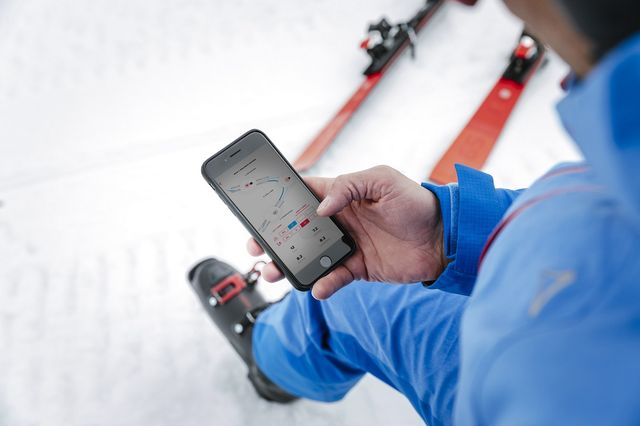 a skier looking at his phone