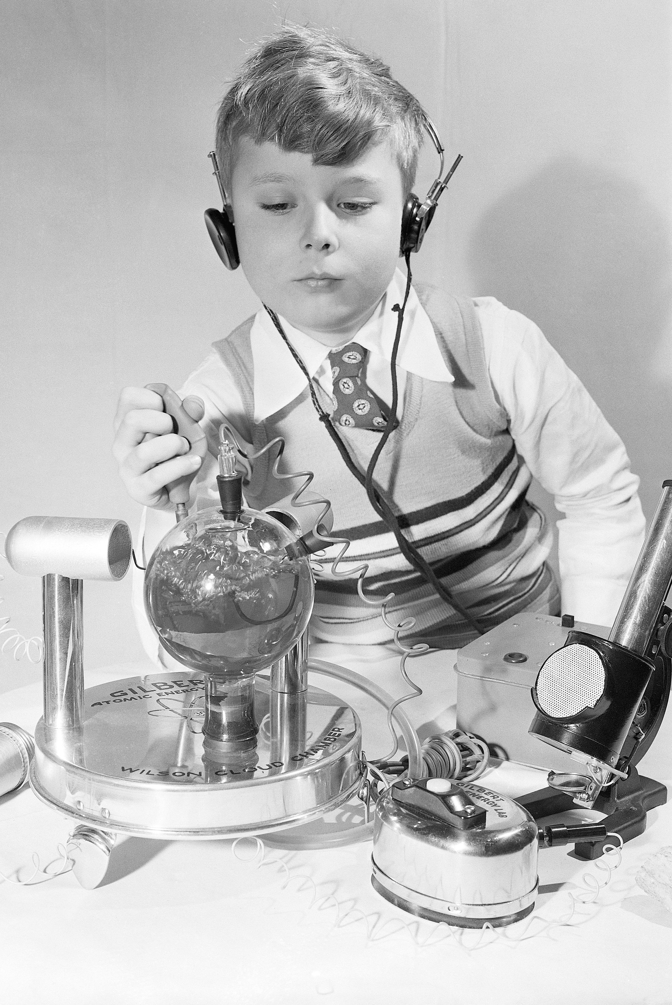 Boy Playing with Toy Atomic Laboratory