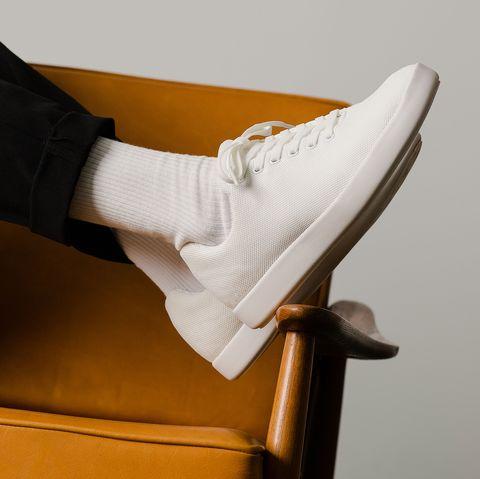 White, Footwear, Leg, Hand, Arm, Shoe, Joint, Furniture, Finger, Comfort,