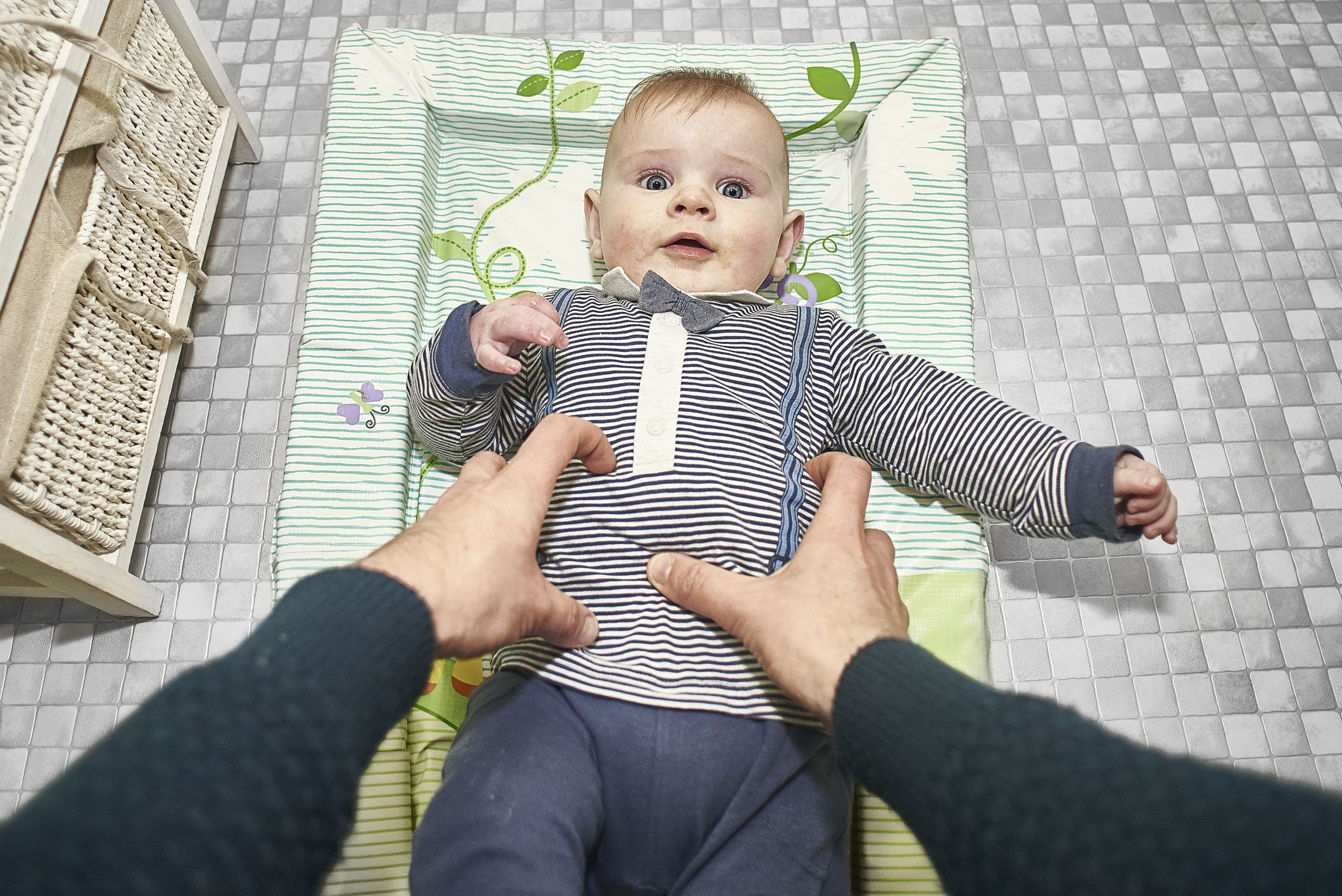 POV of child on a changing mat