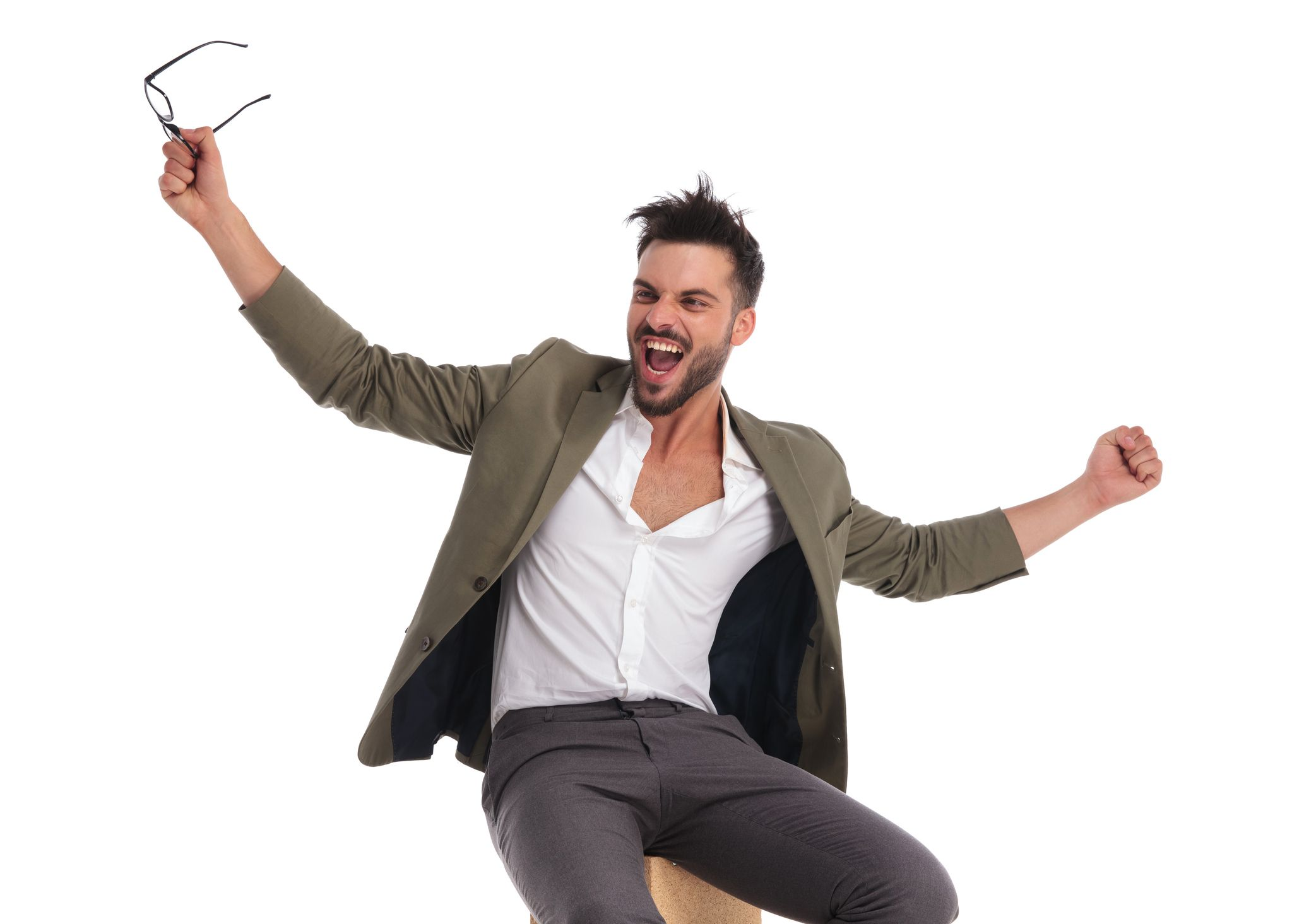 excited elegant man celebrating while looking to side