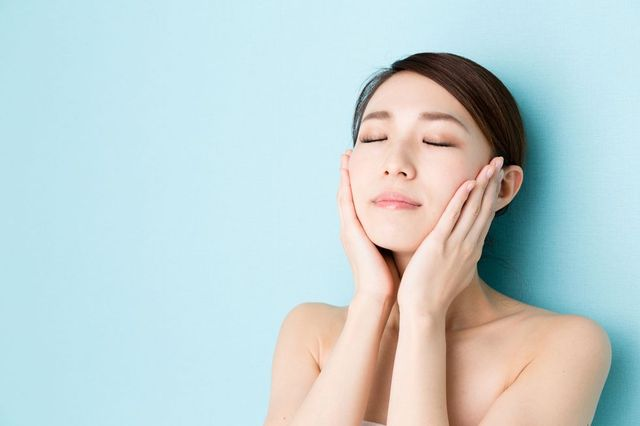 attractive asian woman beauty image isolated on blue background