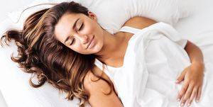 Attractive Young Hispanic Woman Sleeping Blissfully