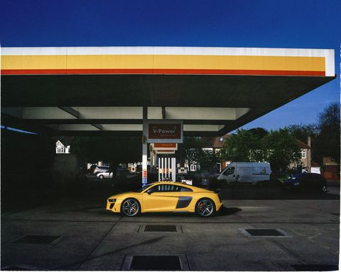 Vehicle, Yellow, Car, Automotive design, Filling station, Sky, Supercar, Luxury vehicle, Sports car, Building,