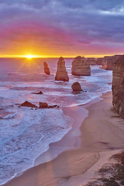 Rocky coast with the Twelve Apostles at sunset, Great Ocean Road, Port Campbell National Park, Victoria
