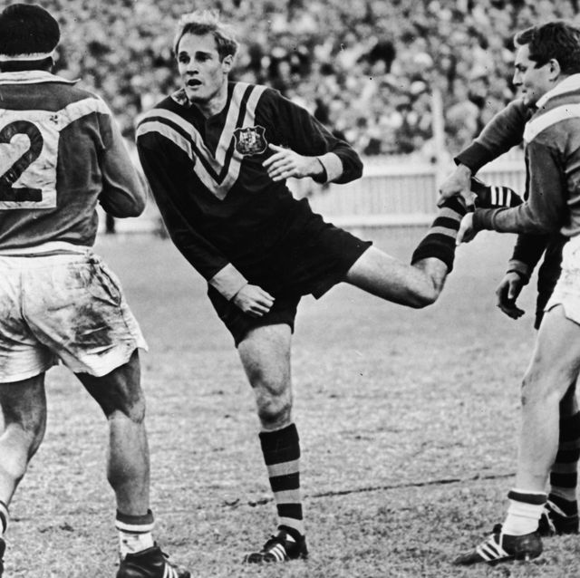 johnny rhodes throws punch in rugby