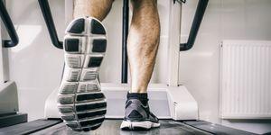 Austria, Klagenfurt, man running on treadmill