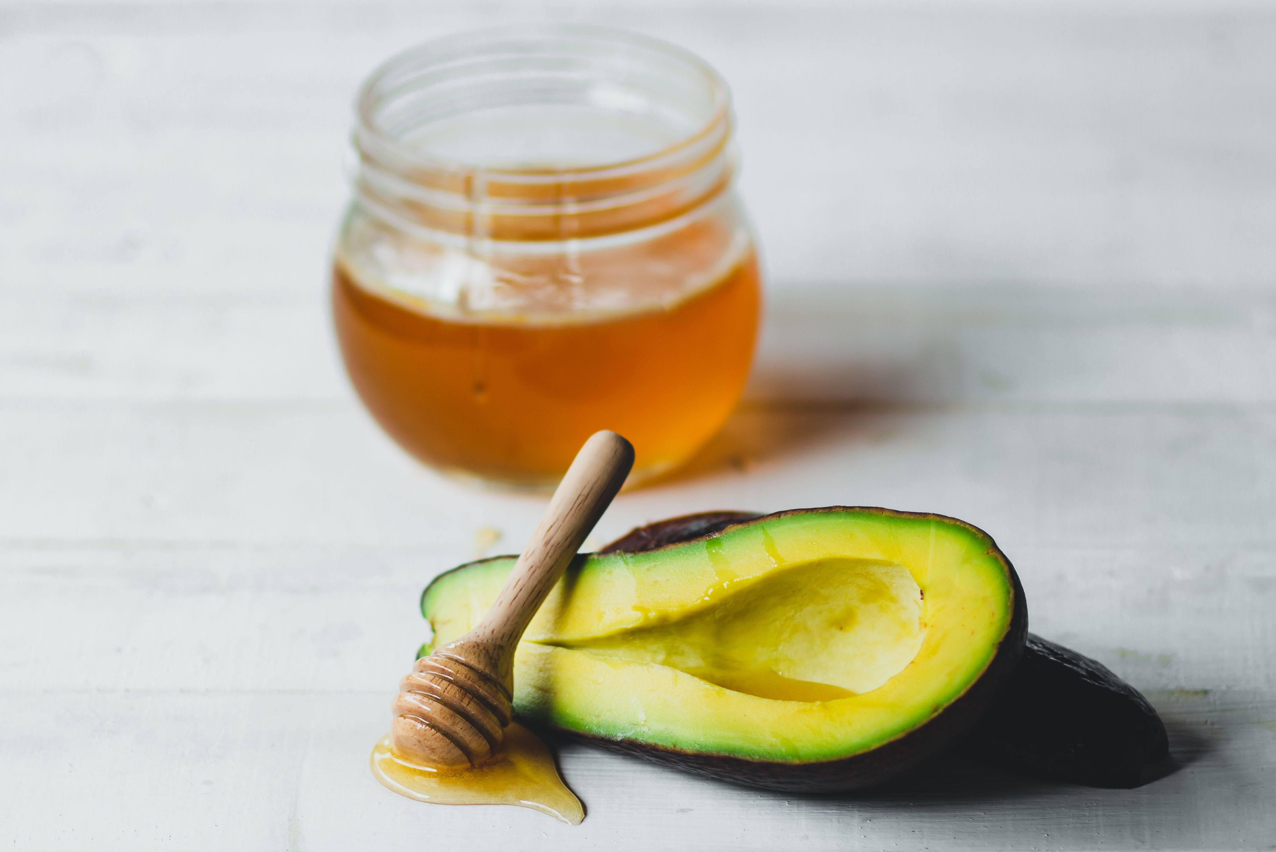 Avocado and honey On the white table
