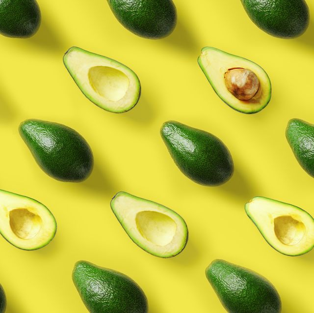 avocado pattern on yellow background pop art design, creative summer food concept green avocadoes, minimal flat lay style top view