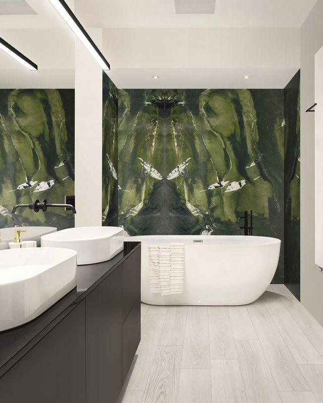 elegant bathroom in marble tiles on walls and floor, with big oval bathtub and two wash basins