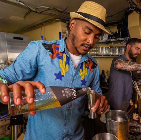 A bartender pours Avua Balsamo Cachaça