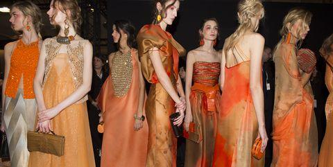 Hairstyle, Orange, Fashion, Dress, Fashion model, One-piece garment, Gown, Model, Peach, Costume design,