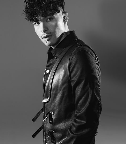 Jacket, Sleeve, Collar, Textile, Standing, Outerwear, Style, Monochrome, Black hair, Jheri curl,