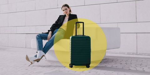 Yellow, Baggage, Sitting, Leg, Suitcase, Furniture, Travel, Luggage and bags, Hand luggage,