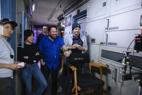 away l to r writer jessica goldberg and writer andrew hinderaker in episode 101 of away cr diyah peranetflix © 2020