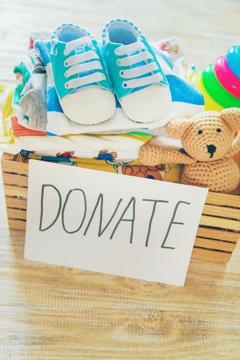 toy organization ideas - Baby clothing and donation accessories. Selective focus.