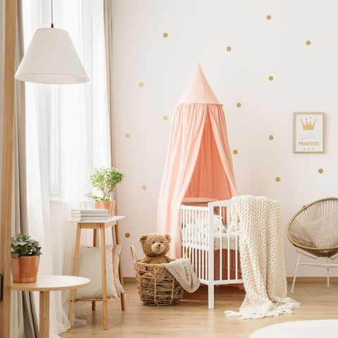 Baby nursery in pink and white with crib