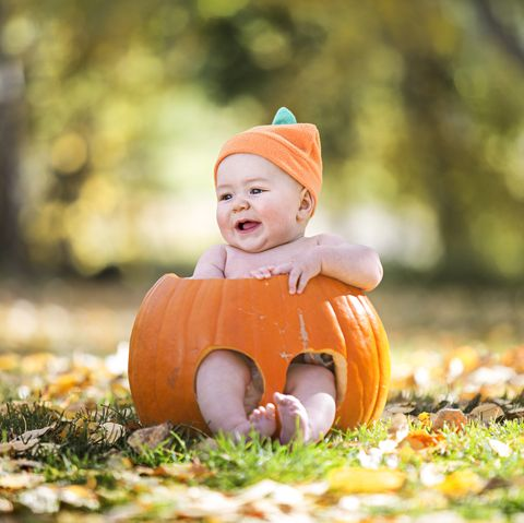 baby sits in a pumkin for this halloween tribute shoot