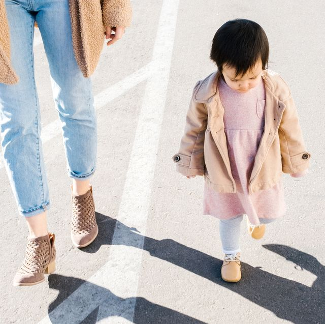 baby wearing shoes to walk with mom