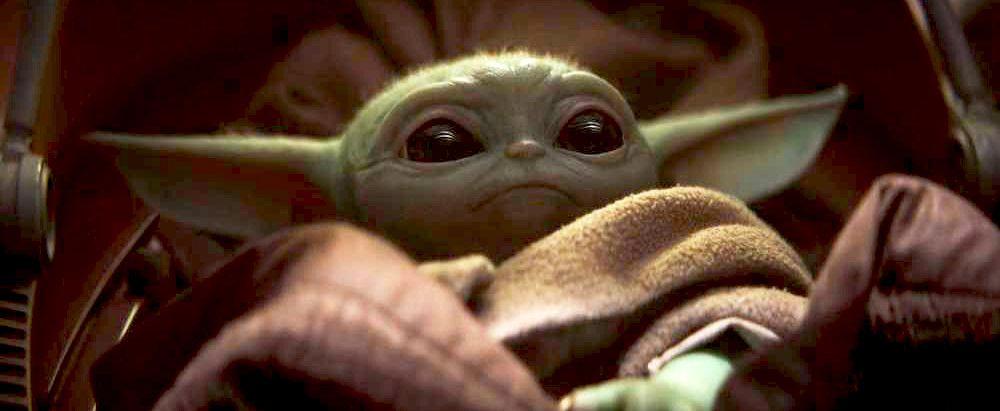 The Mandalorian star teases Baby Yoda's true identity
