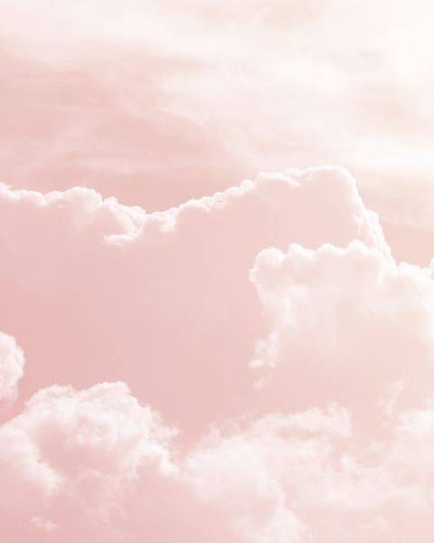 Background of a sky of pink soft color with white clouds.
