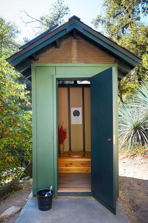 stylish backyard outhouse