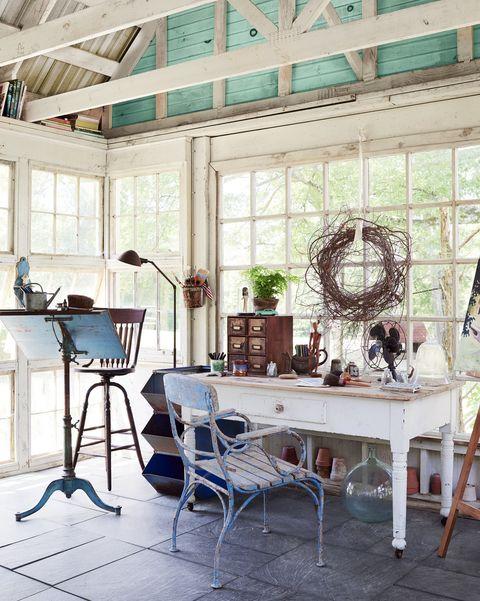 artist studio in white salvaged window wrapped backyard retreat