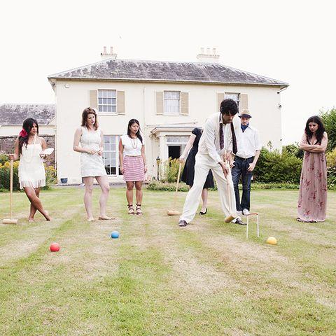 Backyard Wedding Ideas - Friends playing croquet in backyard