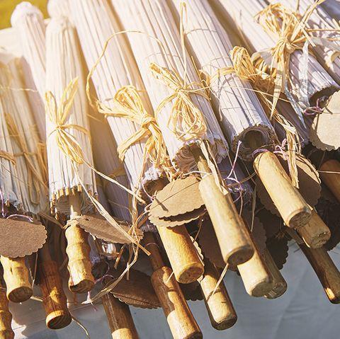 Backyard Wedding Ideas - A pile of wooden umbrella for wedding souvenir with empty name tag, close-up