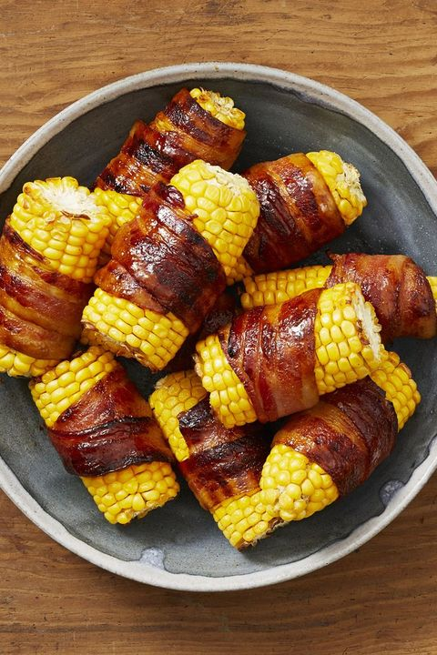 bacon wrapped corn on the cob in a bowl