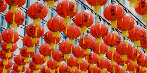 strings of red lanterns with gold tassels hanging