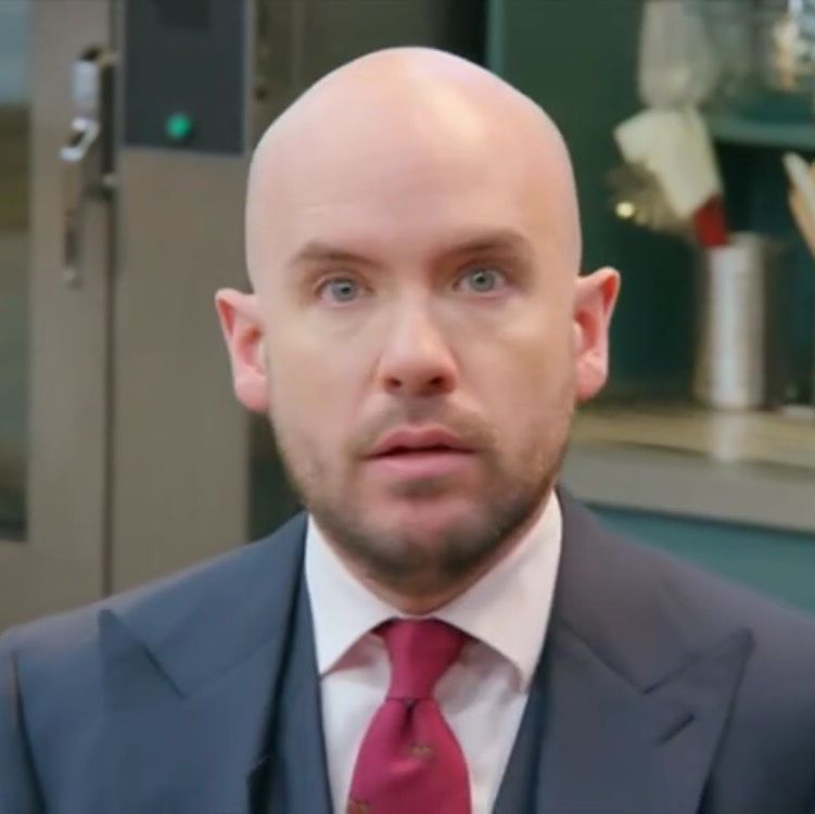 Bake Off: The Professionals co-presenter Tom Allen breaks one of the baker's cakes