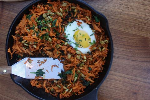 Baked eggs with sweet potato has and pumpkin seeds