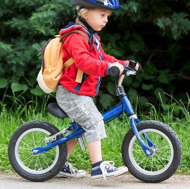 toddler riding blue balance bike