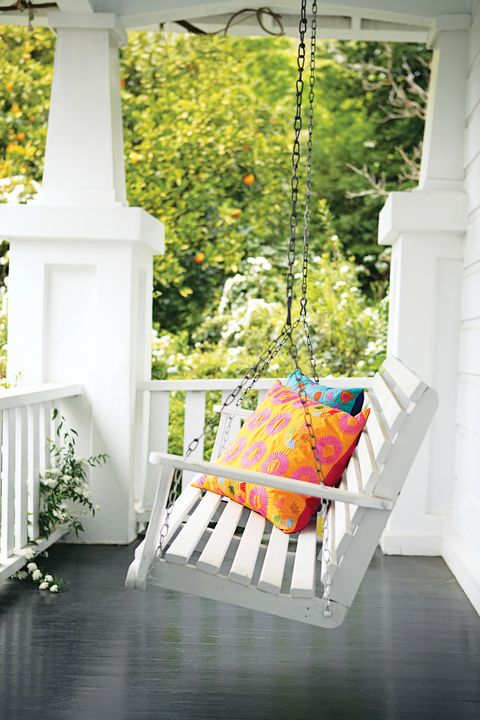 balcony with swing bench and pillows