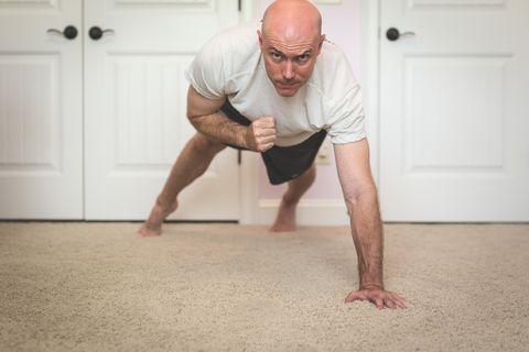bald man exercising