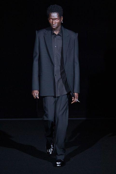 Suit, Clothing, Formal wear, Fashion, Outerwear, Standing, Tuxedo, Blazer, Human, Fashion design,