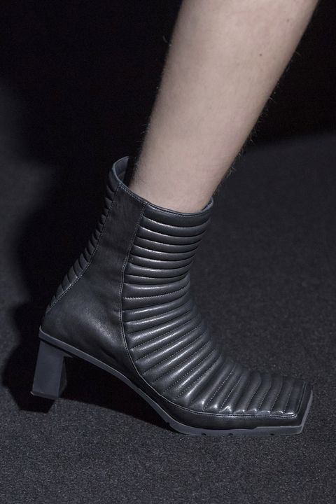 Footwear, Black, Shoe, Joint, Leg, Ankle, Human leg, Fashion, High heels, Boot,