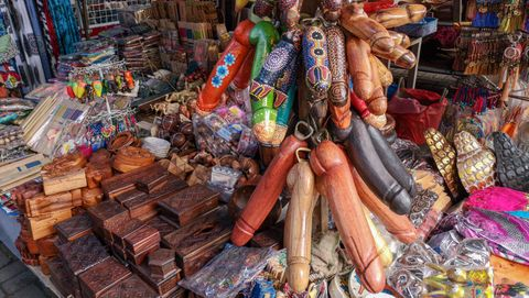 Balinese souvenirs and wooden decorated Penis in a market in Ubud
