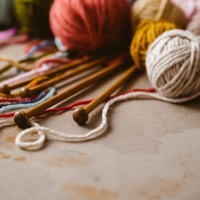 balls of wool and knitting needles