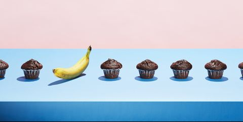 A banana in a row of chocolate cupcakes