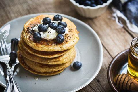 Banana Oat Pancakes with Blueberries, Coconut cream and Chia topping